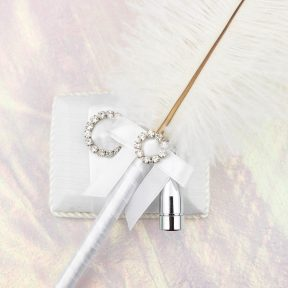 Round Silver Diamante Buckle White Feather Pen