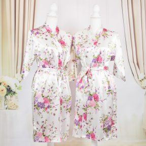 white satin robe with floral designs