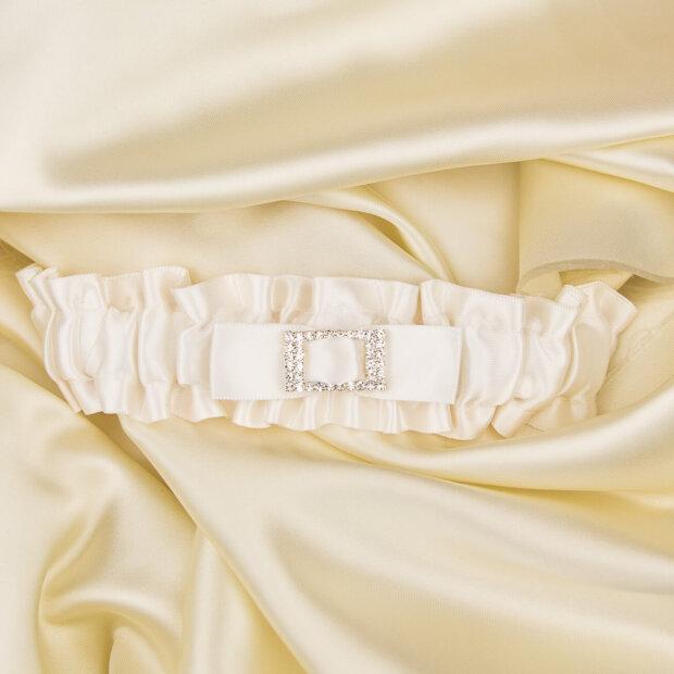 ivory satin bridal garter with a diamante buckle centre
