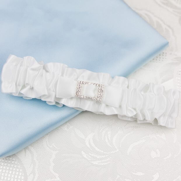 white satin bridal garter with diamante buckle centre