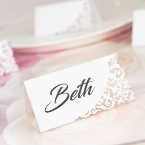 divine name place card with decorative laser cut corner
