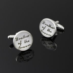 round white cufflinks with brother of the groom written in black cursive