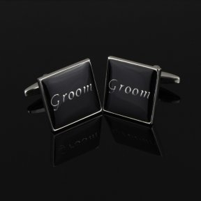 black square cufflinks with silver trim and groom written in silver